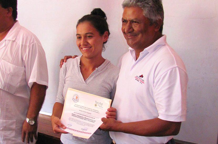 Girl holding award TECAP Murra Nicaragua